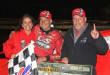 Wade Hendrickson celebrates his big win with car owners Craig and Leslie Pondish.  (Photo Credit: Jim Brown)